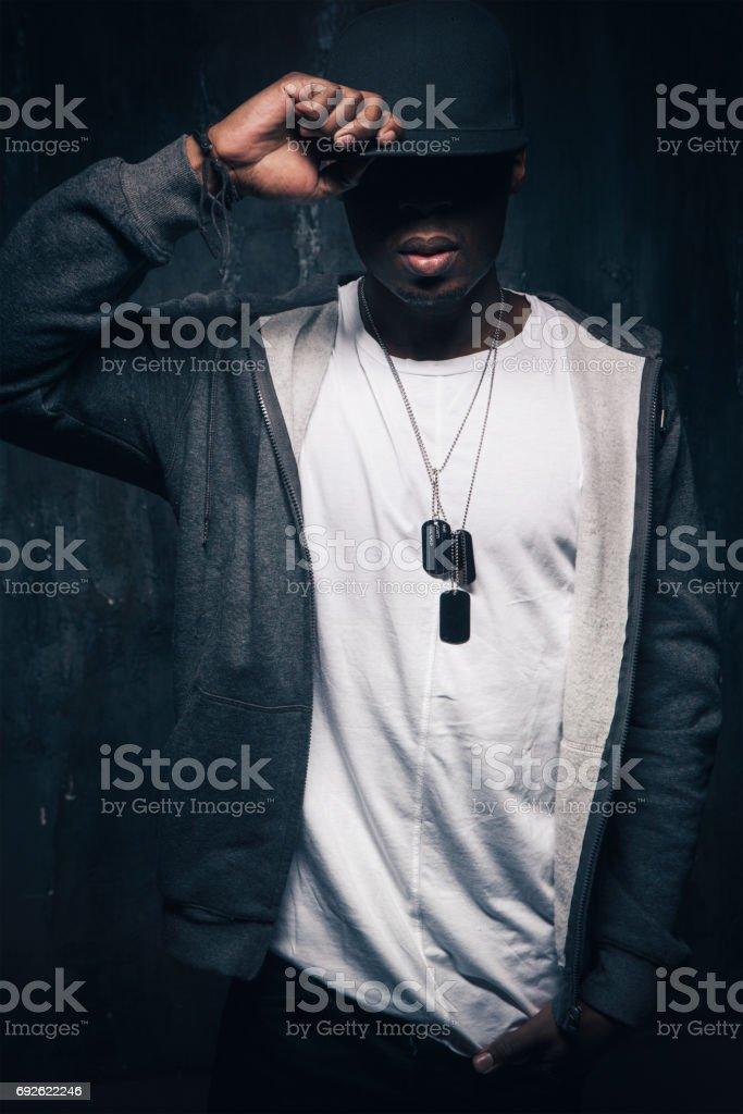 Dangerous unrecognizable black rapper man stock photo