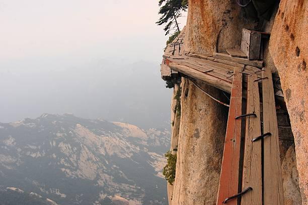 Dangerous walkway at top of holy Mount Hua Shan, China stock photo
