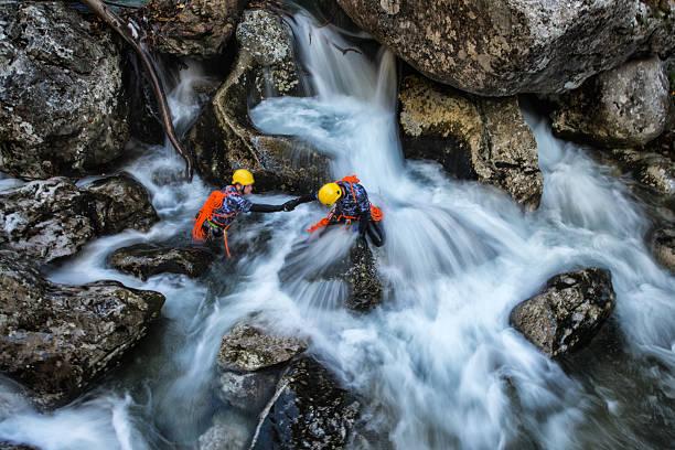 Dangerous waterfall crossing stock photo