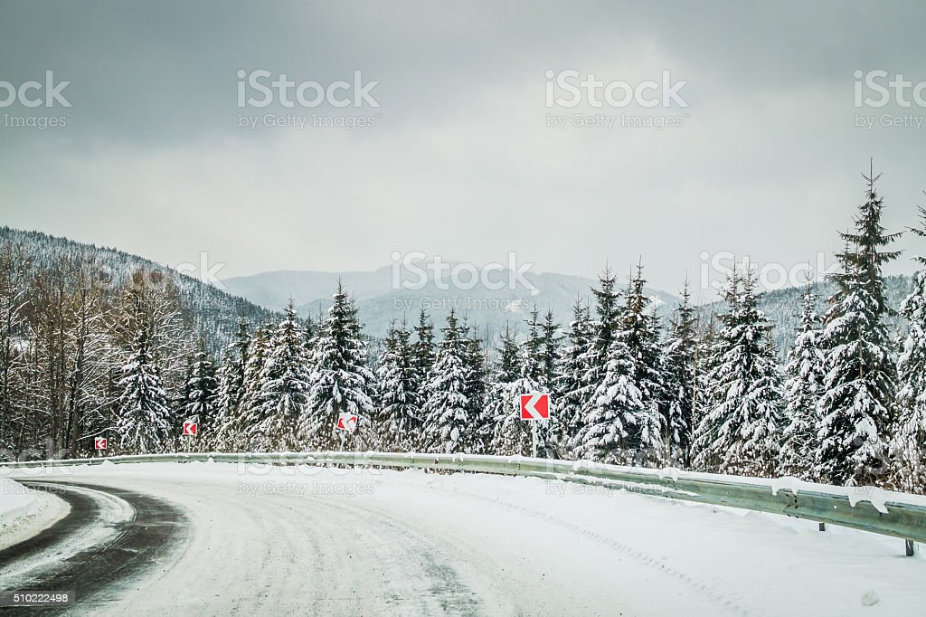 Dangerous winding road in the Carpathian mountains stock photo