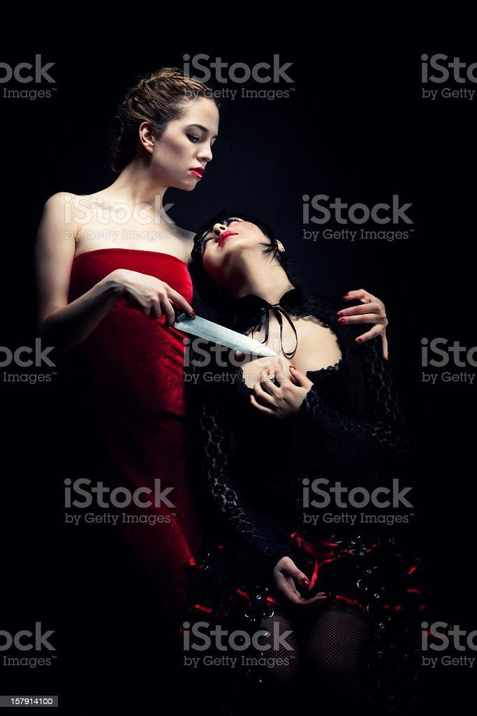 Dangerous young woman royalty-free stock photo