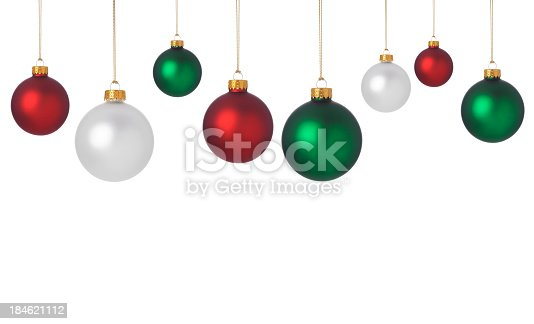 A border of red, white and green Christmas baubles on a white background with copy space for your Holiday text.