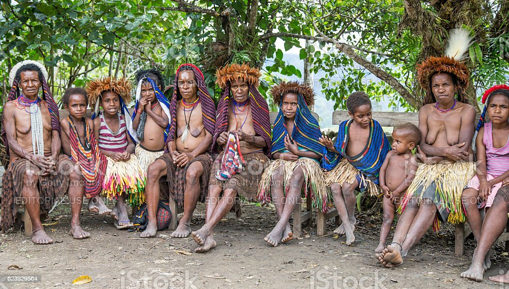 dani ladies sitting in Ugem Village stock photo
