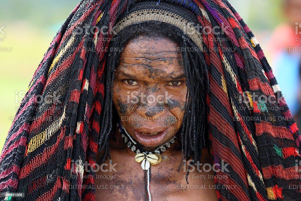 Dani woman in traditional dress.  Wamena, Papua, Indonesia stock photo