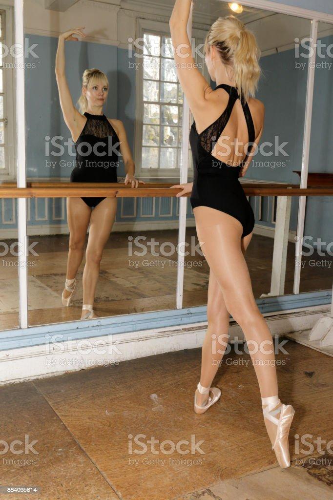 Danish ballerina adopts the 4th position in ballet practise stock photo