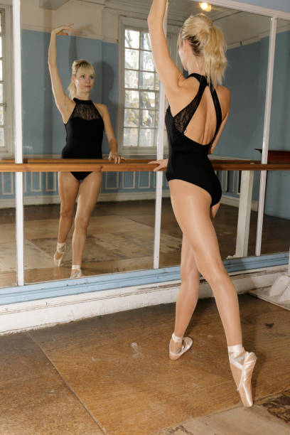 danish ballerina adopts the 4th position in ballet practise - whiteway danish stock photos and pictures