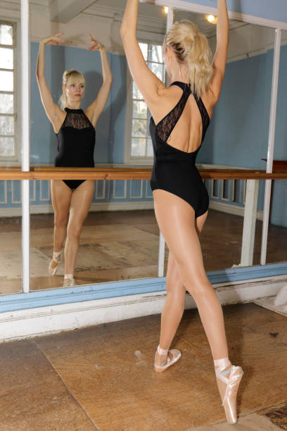 danish ballerina adopts the 5th position in ballet practise - whiteway danish stock photos and pictures