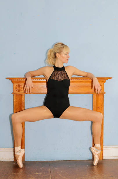 danish ballerina en pointe before mantel filled in fireplace - whiteway danish stock photos and pictures