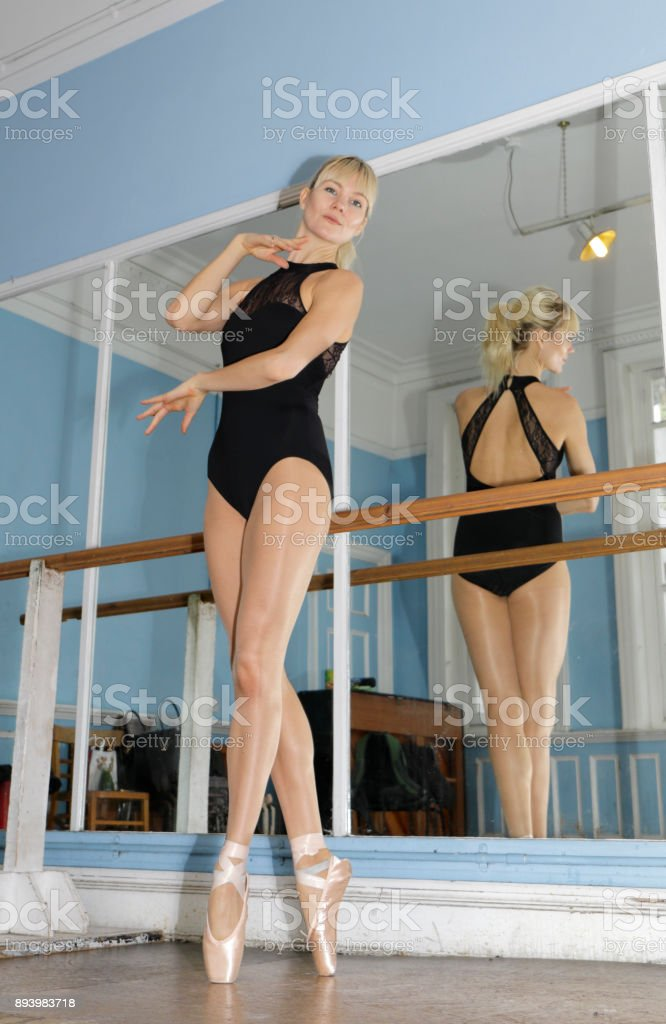 Danish ballerina en pointe position in ballet practise London stock photo