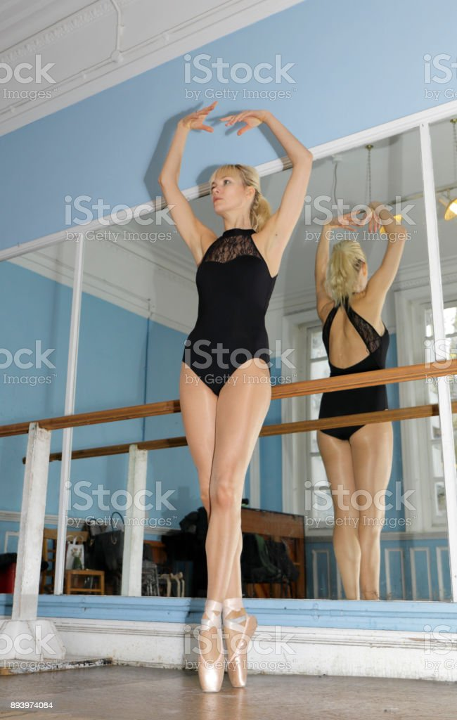 Danish ballerina en pointe position in ballet practise stock photo