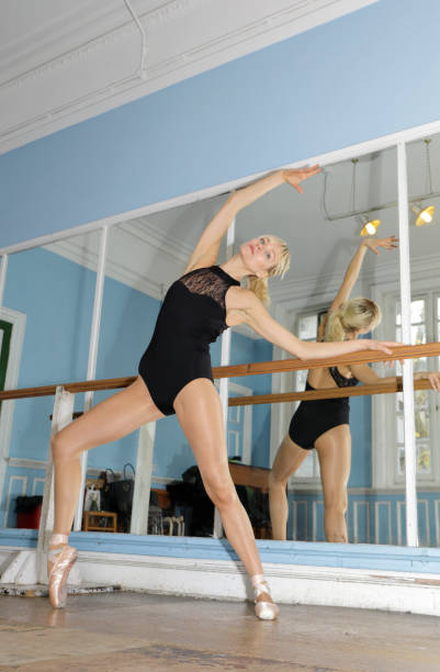 danish ballerina exercising en pointe in ballet practise london - whiteway danish stock photos and pictures