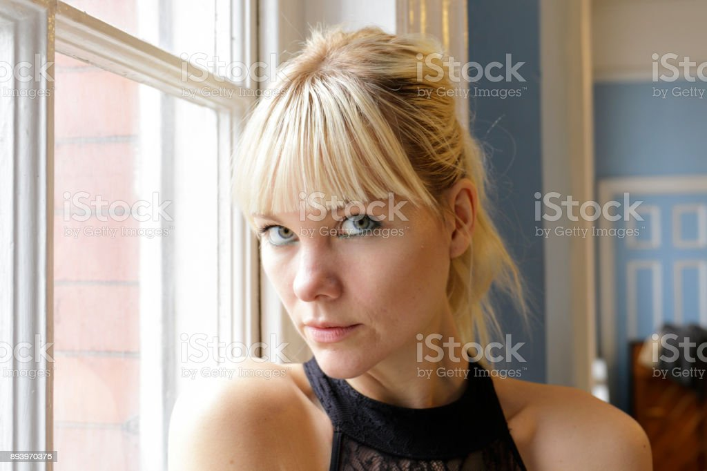 Danish ballerina in window light portrait head shot London stock photo