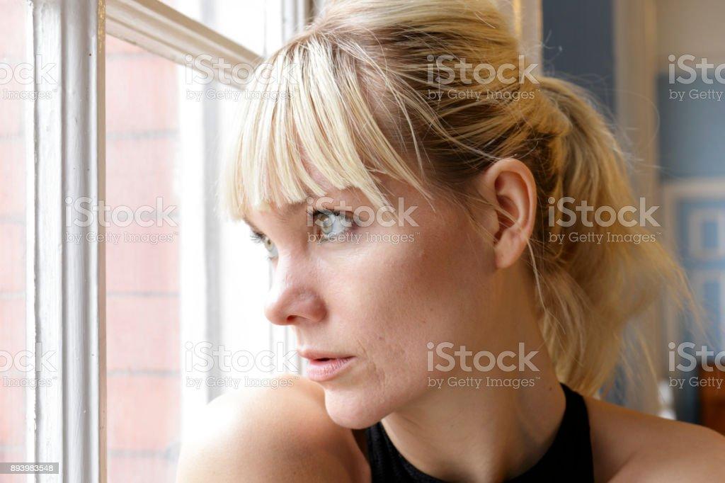 Danish ballerina looking out window light portrait head shot London stock photo
