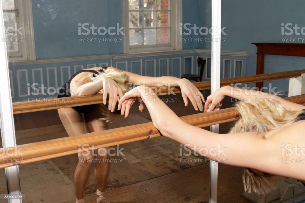 Danish ballerina stretching back exercise with ballet practise bar stock photo