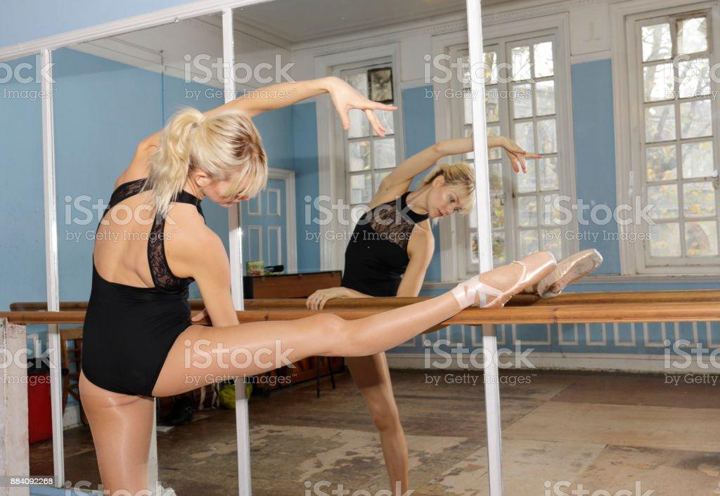 Danish ballerina stretching exercise in ballet practise bar stock photo