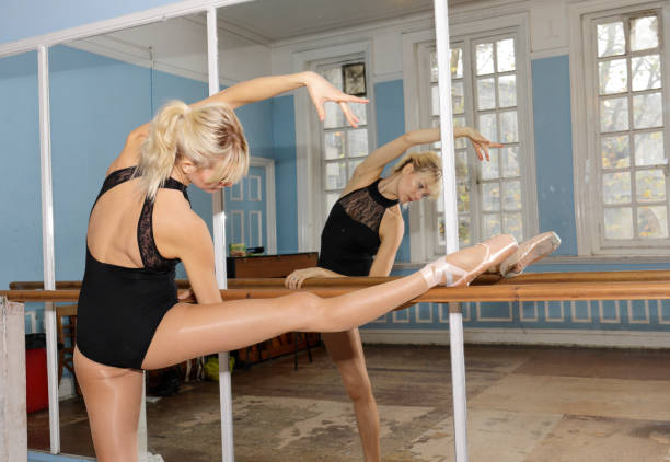 danish ballerina stretching exercise in ballet practise bar - whiteway danish stock photos and pictures