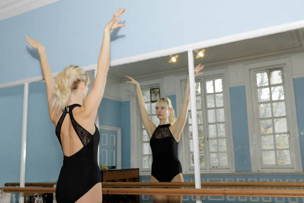 danish ballerina stretching exercise in ballet practise bar - whiteway ballet stock photos and pictures