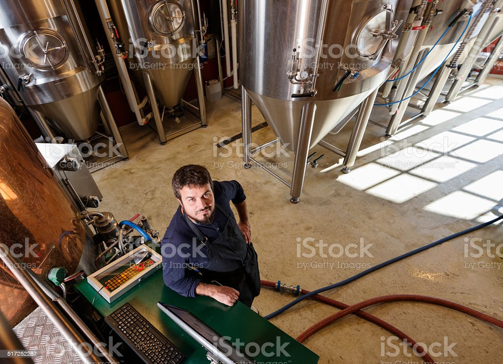 Danish brewmaster at work in a microbrewery stock photo