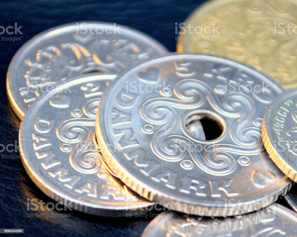 Danish coins against a black background stock photo