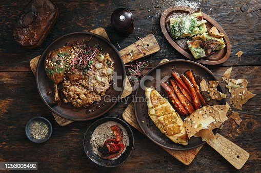 istock Danish Dishes for Family Dinner. Sous Vide Chicken Breast and Slow Cooker Duck Leg Confit 1253008492