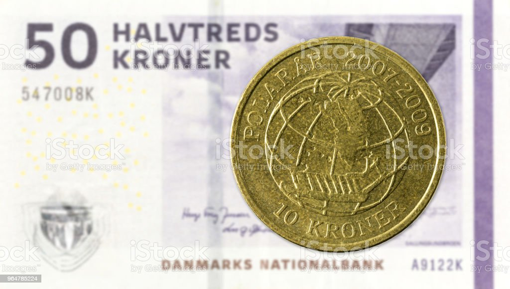 10 danish krone coin against 50 danish krone note royalty-free stock photo
