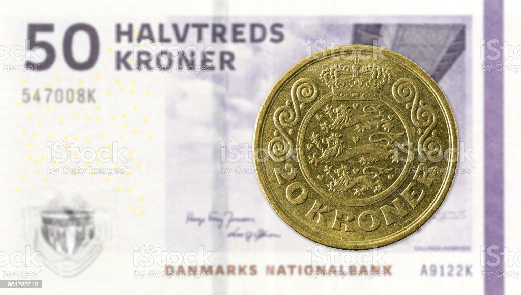 20 danish krone coin against 50 danish krone note royalty-free stock photo