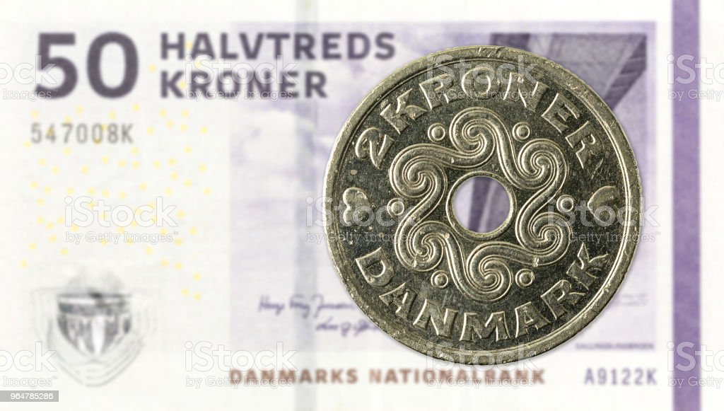 2 danish krone coin against 50 danish krone note royalty-free stock photo