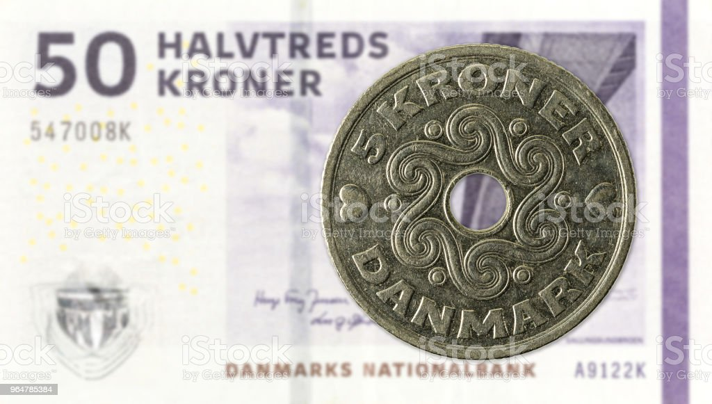 5 danish krone coin against 50 danish krone note royalty-free stock photo
