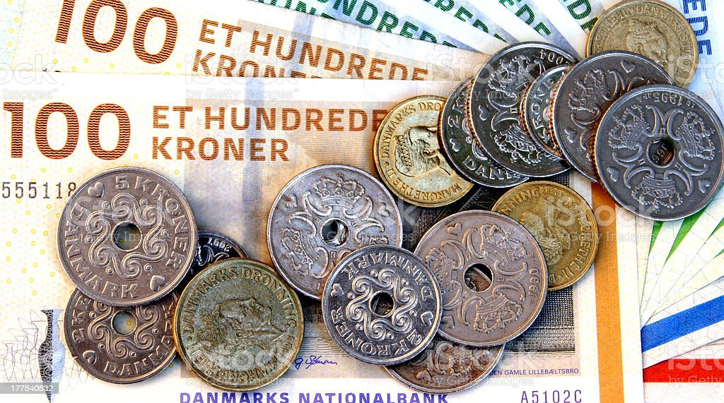 Danish money as coins and bills on top of each other stock photo