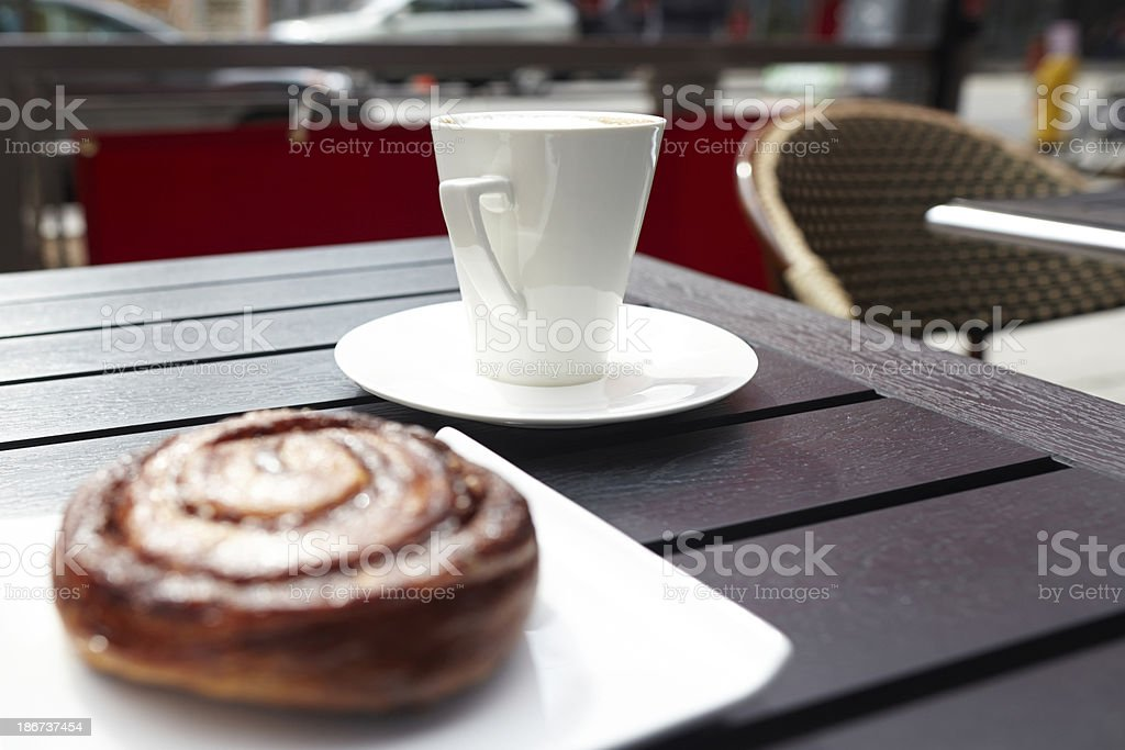 Danish pastry on table with cappuccino cup royalty-free stock photo