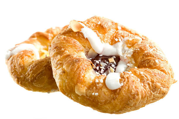Danish pastry on white background Delicious pastry isolated on white. pastry dough stock pictures, royalty-free photos & images