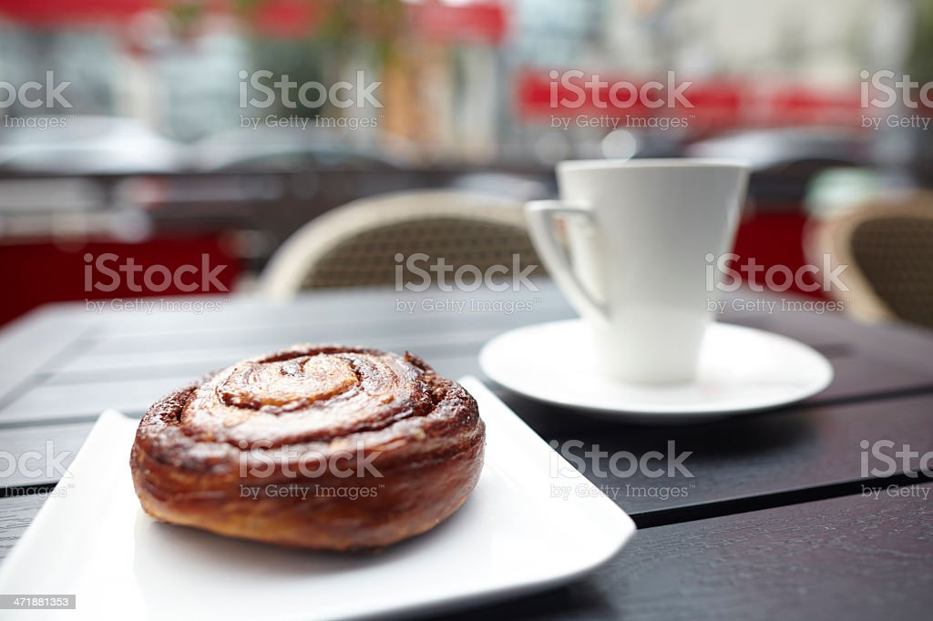 Danish pastry with coffee cup on table royalty-free stock photo
