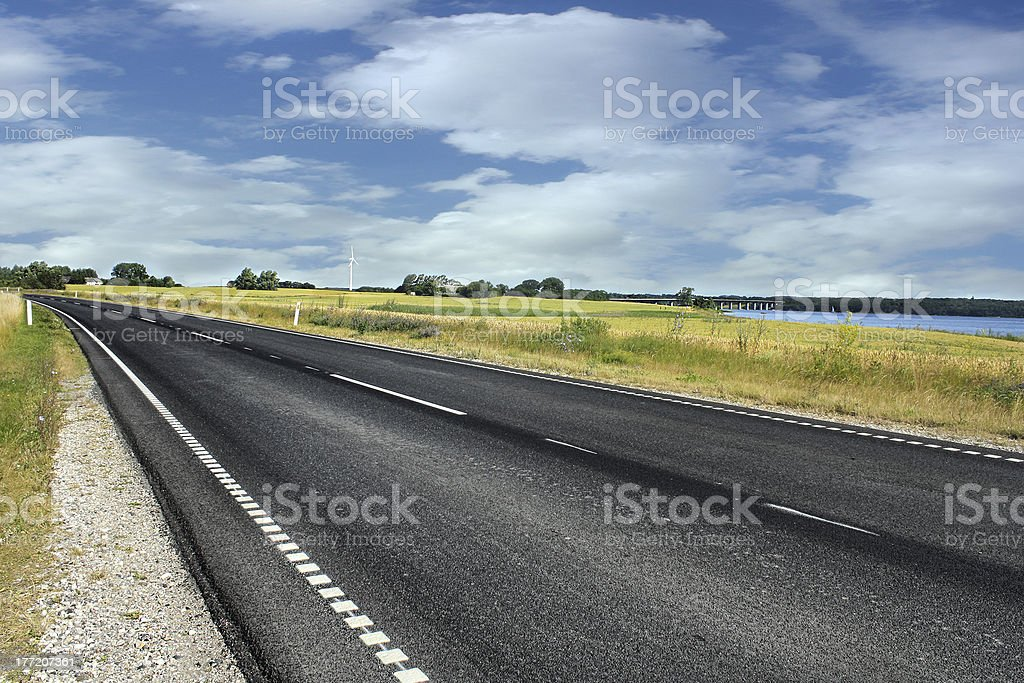 Danish road in middle of a country stock photo