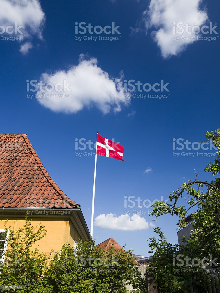 Dannebrog and yellow house royalty-free stock photo