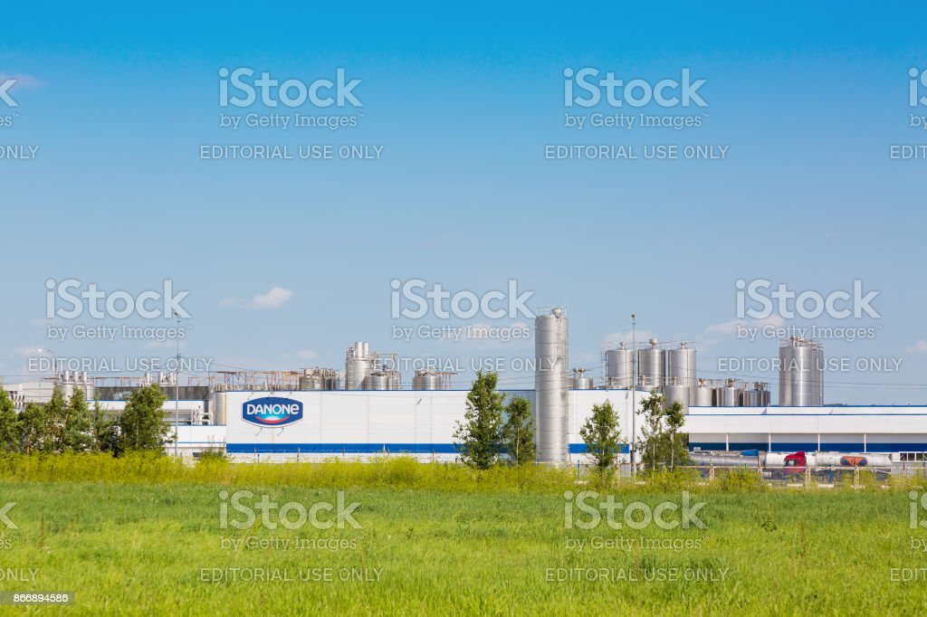 Danone factory in Russia with green grass and blue sky
