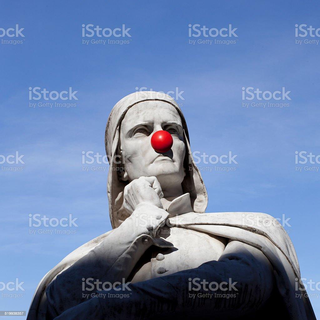 Dante Alighieri statue with a clown nose stock photo