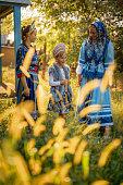istock ROMANIA, DANUBE DELTA, AUGUST 2019: Danube Delta, Romania, Lipovans women in traditional costumes in Mila 23 village in the heart of the Danube Delta 1212772152