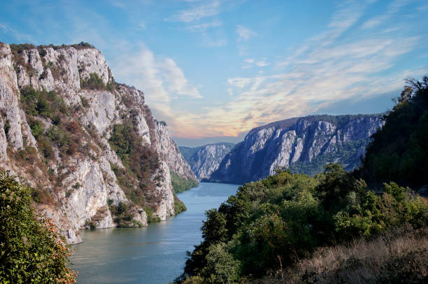 danube river near the serbian city of donji milanovac in the iron gates also known as djerdap which are the danube gorges a natural symbol of the border between serbia and romania. - serbia stock photos and pictures