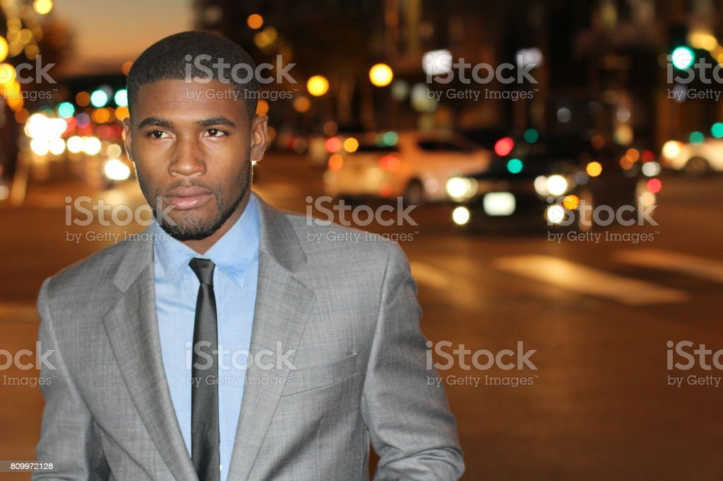 Dapper gentleman outside at night stock photo