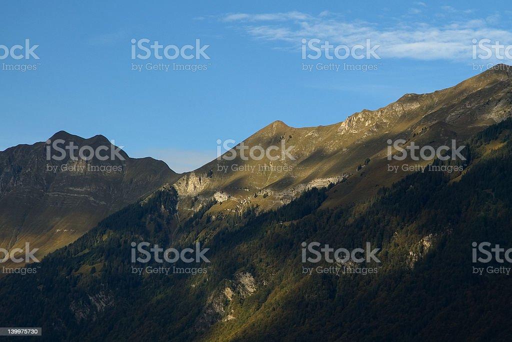 Dappled autumn sunshine on Alpine mountains royalty-free stock photo