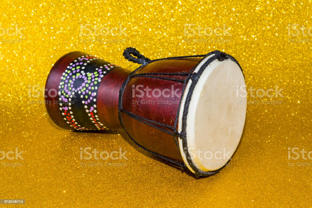 Darbuka on a yellow background two pieces. African drum toned stock photo
