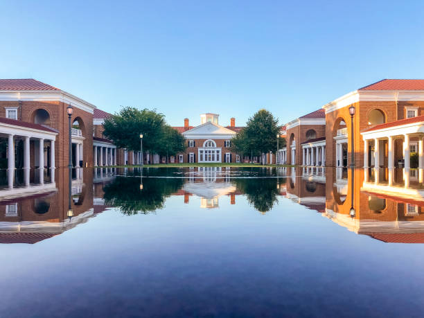 Darden School of Business University of Virginia Campus Building Refection This photo was taken in the Darden School of Business, University of Virginia. As one of the UNESCO historical sites, these buildings are in typical Jeffersonian architecture styles. The reflections of the buildings and the sky are truly beautiful. charlottesville stock pictures, royalty-free photos & images