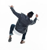 Daring young handsome male in mid air falling and jumping