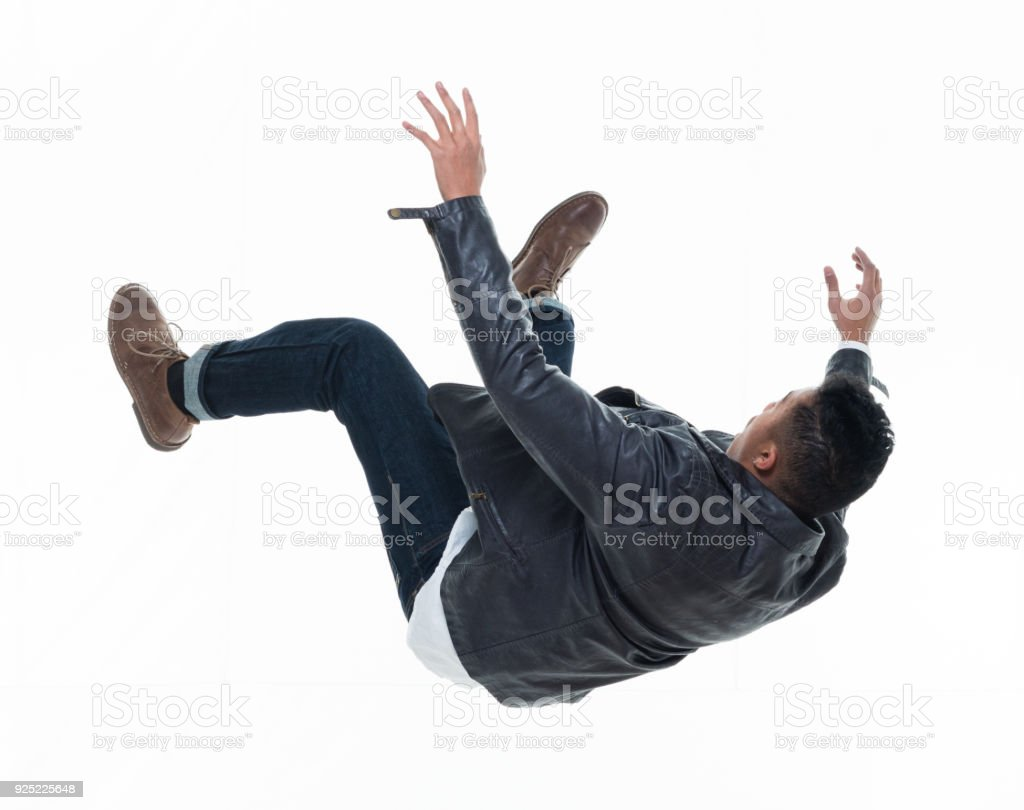 Daring young handsome male in mid air falling and jumping stock photo
