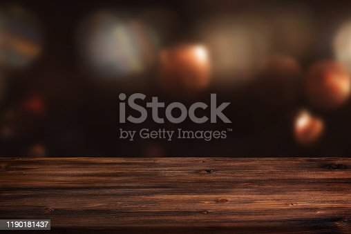 Dark abstract background with rustic wooden table for a christmas decoration concept