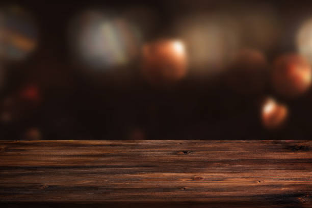 Dark abstract background with wooden table Dark abstract background with rustic wooden table for a christmas decoration concept surface level stock pictures, royalty-free photos & images