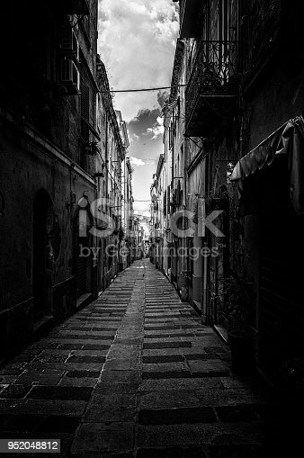 Dark alley in the old town of Sassari city, in Sardinia, in black and white