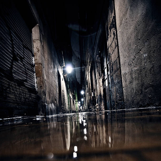 Dark alley. Streets of old town reflected in puddle. alley stock pictures, royalty-free photos & images