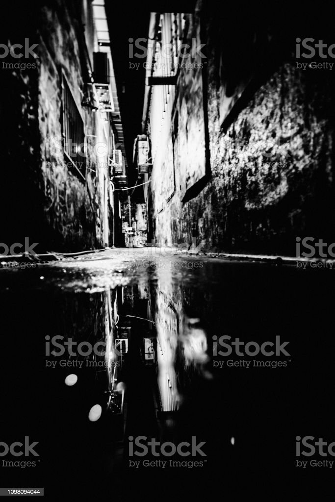 Dark alley reflection - Florentin, Tel Aviv, Israel stock photo