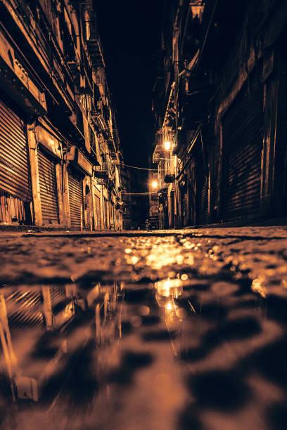 Dark alley reflection - Palermo, Sicily stock photo